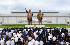 Floral Tribute Paid to Statues of Kim Il Sung and Kim Jong Il