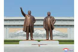 Floral Tributes Paid to Statues of President Kim Il Sung and Chairman Kim Jong Il